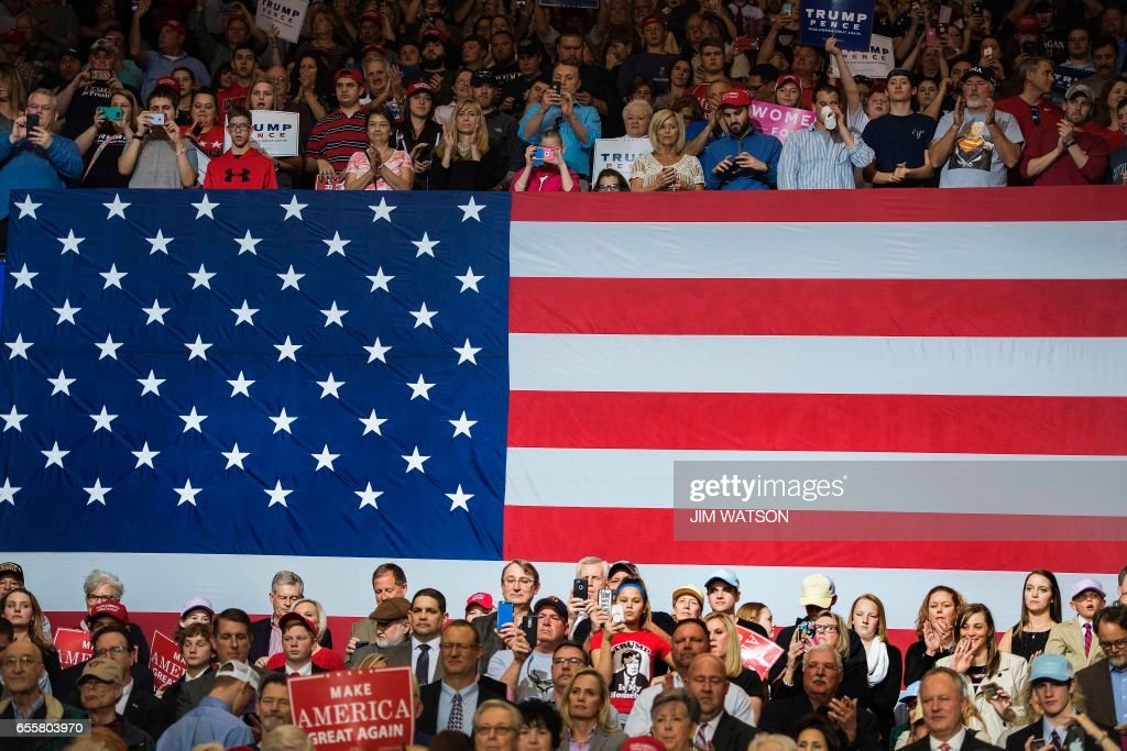 Supporters listen as US President Donald Trump addresses a 'Make America Great Again' rally at the Kentucky Exposition Center in Louisville, Kentucky, March 20, 2017. /
