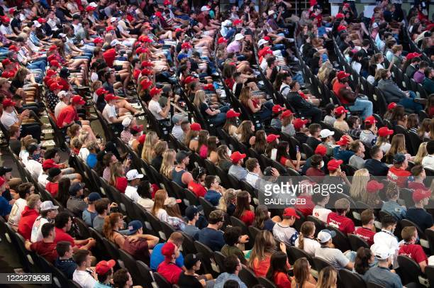 Supporters listen as US President Donald Trump speaks during a Students for Trump event at the Dream City Church in Phoenix, Arizona, June 23, 2020.