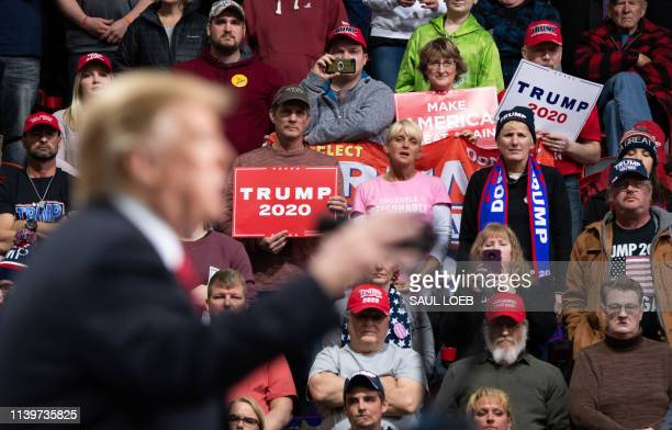 Supporters listen as US President Donald Trump speaks during a Make America Great Again rally in Green Bay, Wisconsin, April 27, 2019.