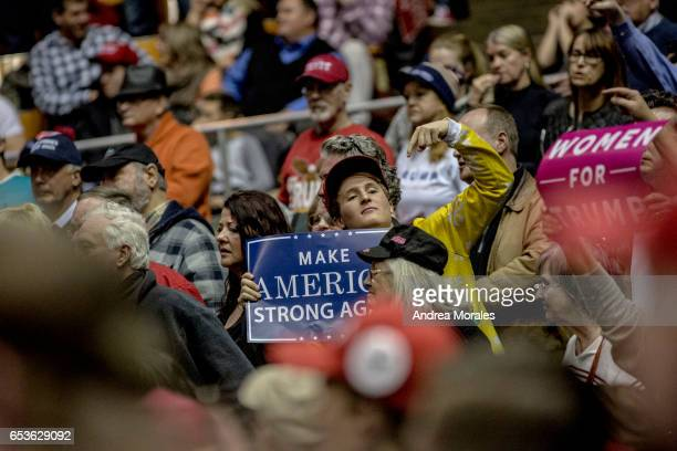 Supporters listen during a rally held by President Trump on March 15 2017 in Nashville Tennessee During his speech President Trump promised to repeal...