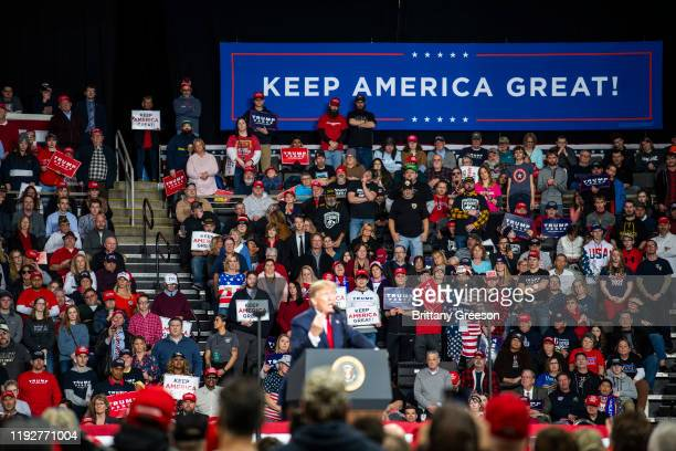 """Supporters listen in the crowd as President Donald Trump speaks at a """"Keep America Great"""" campaign rally at the Huntington Center on January 9, 2020..."""