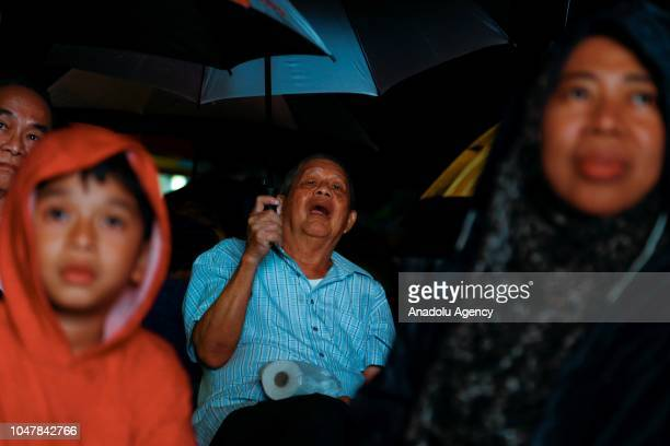 Supporters listen to a speech of Anwar Ibrahim during byelection campaign in Port Dickson Malaysia on 8 October 2018 The support given by Mahathir...