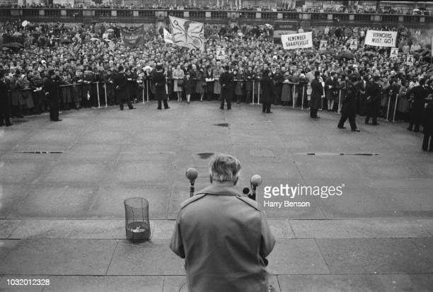 Supporters listen to British Labour Party politician Harold Wilson Leader of the Labour Party giving a speech at an Antiapartheid rally in Trafalgar...