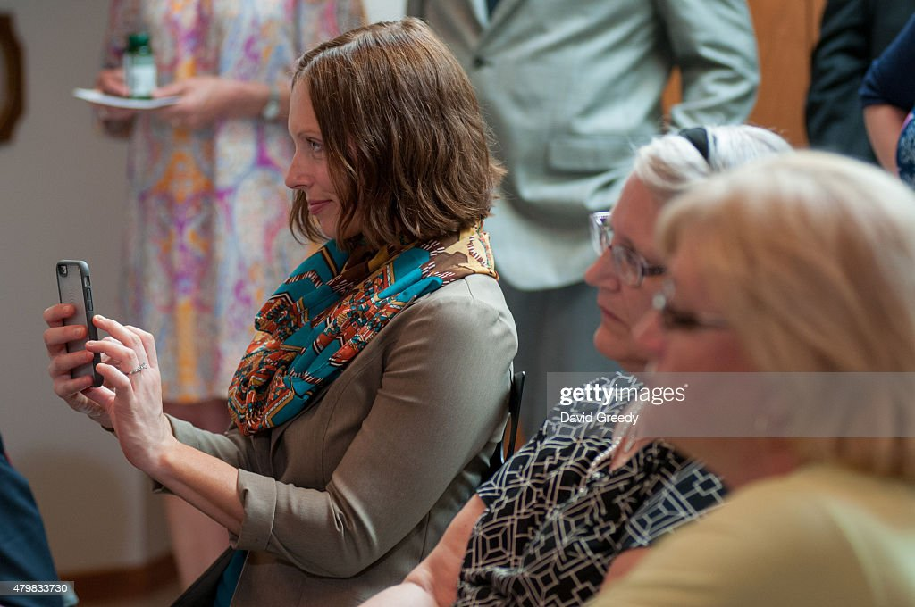Supporters listen to Democratic presidential candidate Hillary Clinton at an organizational rally at the home of Nancy and Dennis Emanuel on July 7, 2015 in Ottumwa, Iowa. Clinton's second stop of the day in Iowa provided the 60 people in attendence with an opportunity to hear from the former Senator and Secretary of State about her platform for her run the office of President of the United States.