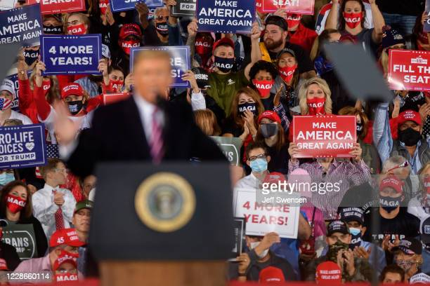 Supporters listen to President Donald Trump speak at a campaign rally at Atlantic Aviation on September 22, 2020 in Moon Township, Pennsylvania....