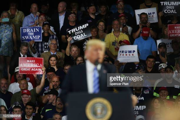 Supporters listen to President Donald Trump speak at the Charleston Civic Center on August 21 2018 in Charleston West Virginia Paul Manafort a former...