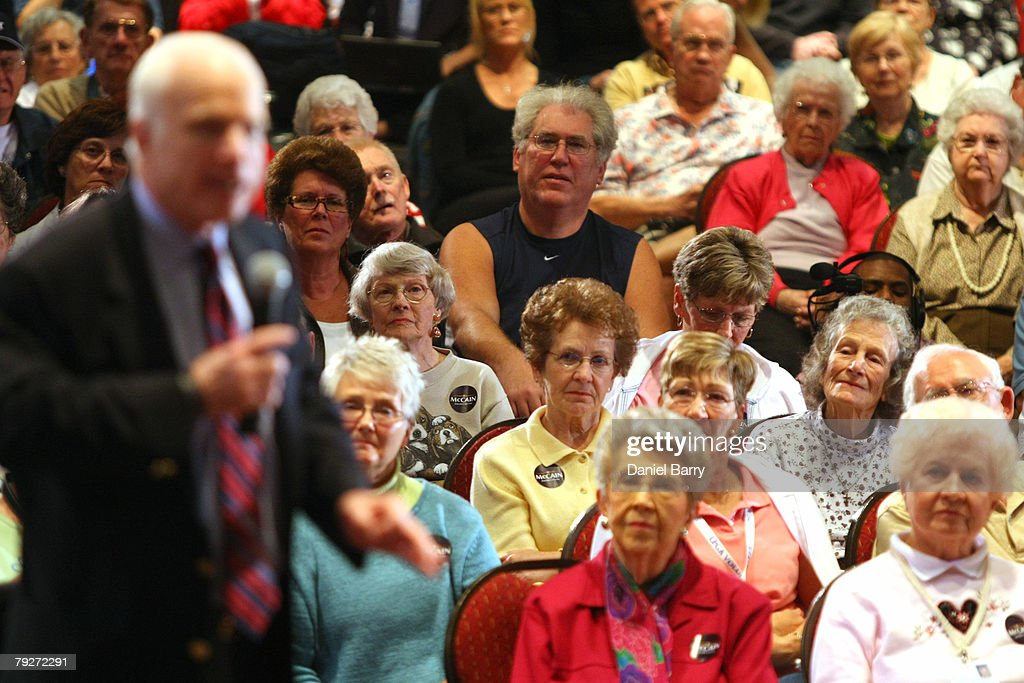 Supporters listen to Republican presidential hopeful Sen. John McCain (R-AZ) during a campaign stop January 26, 2008 in Sun City Center, Florida. Republican presidential candidates continue to campaign in Florida for the upcoming primary.