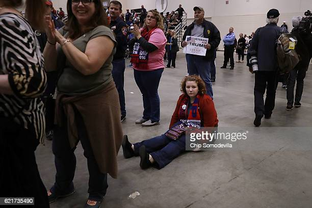 Supporters listen to Republican presidential nominee Donald Trump address his final campaign rally on Election Day in the Devos Place November 8 2016...
