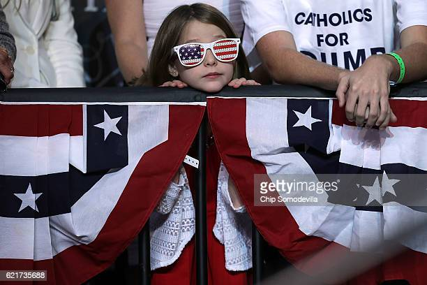 Supporters listen to Republican presidential nominee Donald Trump during his final campaign rally on Election Day in the Devos Place November 8 2016...