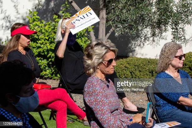 Supporters listen to Sen. Martha McSally during a campaign event on October 29, 2020 in Scottsdale, Arizona. McSally is running against Democratic...
