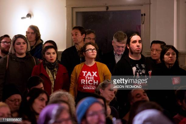 Supporters listen to speakers during a Tax Amazon 2020 Kickoff event and inauguration for Seattle City Councilmember Kshama Sawant in Seattle...