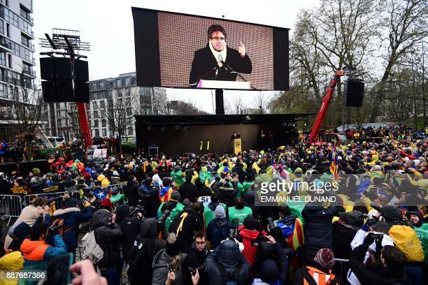 TOPSHOT Supporters listen to the speech of Catalonia's deposed regional president Carles Puigdemont during a proindependence demonstration on...