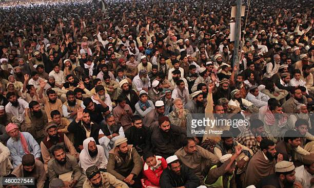 Supporters listen to the speech of Hafiz Muhammad Saeed head of the banned Islamic charity JamatudDawa during the twoday convention in Lahore...