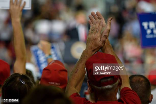 Supporters listen to US President Donald Trump at a rally at the Erie Insurance Arena on October 10 2018 in Erie Pennsylvania This was the second...