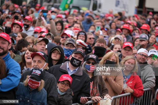 Supporters listen to U.S. President Donald Trump during a campaign event on October 24, 2020 in Circleville, Ohio. President Trump continues to...