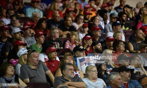 Supporters listen to US President Donald Trump speak at a rally at the Erie Insurance Arena on October 10 2018 in Erie Pennsylvania This was the...