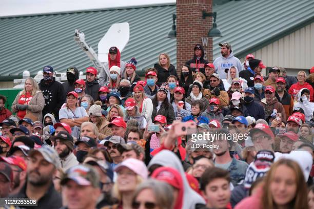 Supporters listen to U.S. President Donald Trump speak during a campaign event on October 24, 2020 in Circleville, Ohio. President Trump continues to...