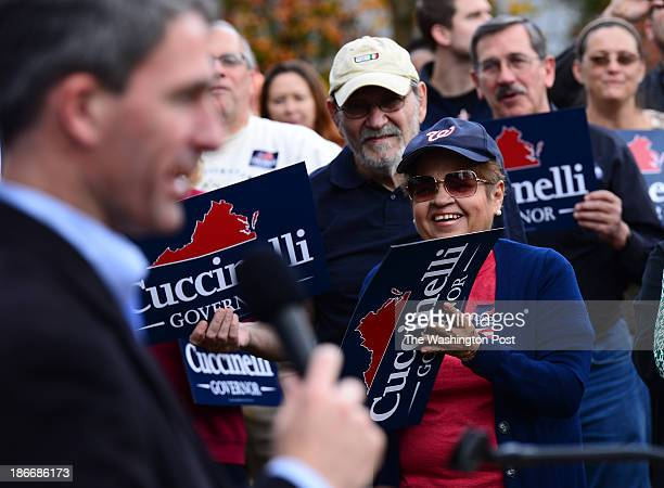 Supporters listen to Virginia Gubernatorial candidate Ken Cuccinelli at a campaign rally in Woodbridge Virginia on November 2 2013 The rally was held...