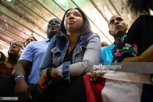 Supporters listen while former President Barack Obama speaks during a campaign rally for Ohio Gubernatorial candidate Richard Cordray at CMSD East...