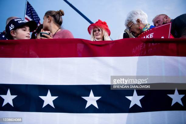 """Supporters listen while US President Donald Trump speaks at a """"Great American Comeback"""" rally in Fayetteville, North Carolina, on September 19, 2020."""