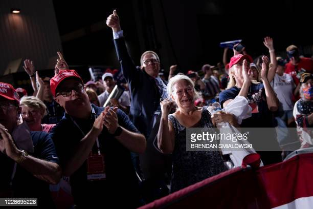 Supporters listen while US President Donald Trump speaks during a campaign rally at Cecil Airport on September 24 in Jacksonville, Florida.