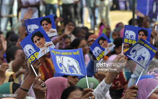 Supporters listening to Bahujan Samaj Party chief Mayawati during an election campaign rally at Leisure Valley on March 25 2014 in Gurgaon India
