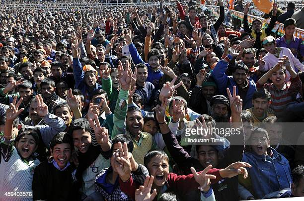 BJP supporters listening to Prime Minister Narendra Modi during an election campaign rally at Kishtwar on November 22 2014 about 260 Km from Jammu...