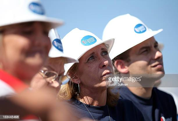 Supporters look on as Republican presidential candidate former Massachusetts Gov Mitt Romney speaks during a campaign rally on October 5 2012 in...