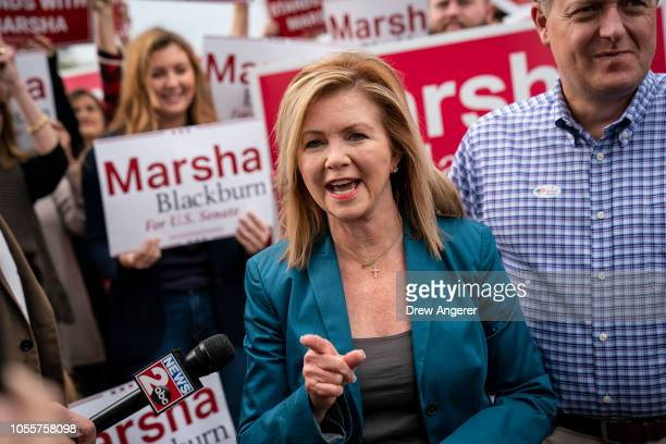 Supporters look on as US Rep Marsha Blackburn Republican candidate for US Senate speaks to reporters after she cast her ballot during early voting at...