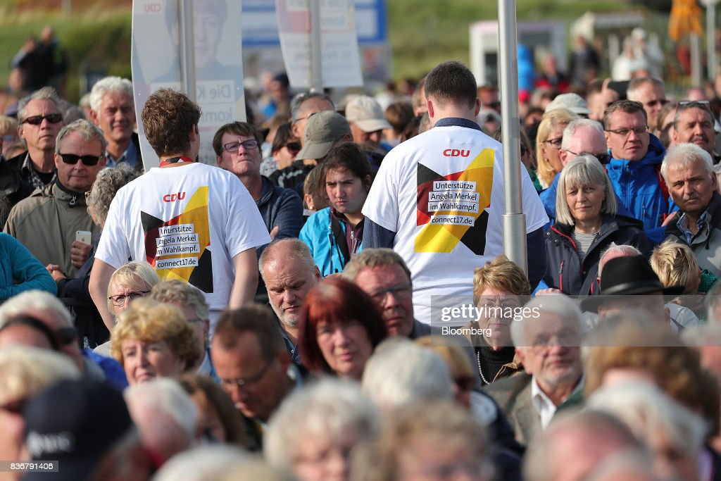 Supporters look on during a Christian Democratic Union (CDU) election campaign stop in Saint Peter-Ording, Germany, on Monday, Aug. 21, 2017. Germany's Chancellor and CDU leader Angela Merkel headed out on the campaign trail last week and quickly faced disruption by anti-immigration demonstrators, a reminder that the refugee crisis that sent her popularity plunging in 2016 remains a residual risk. Photographer: Krisztian Bocsi/Bloomberg via Getty Images