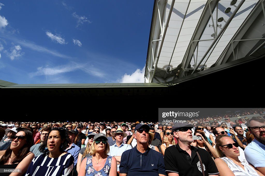 Supporters look on in Centre Court on Middle Sunday of the Wimbledon Lawn Tennis Championships at the All England Lawn Tennis and Croquet Club on July 3, 2016 in London, England.
