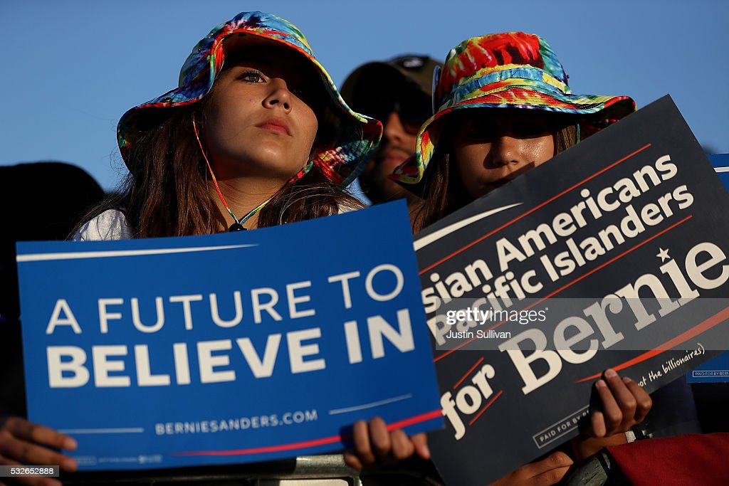 Supporters looks on as Democratic presidential candidate Sen. Bernie Sanders speaks at a campaign rally at Waterfront Park on May 18, 2016 in Vallejo, California. A day after winning the Oregon primary, Bernie Sanders is campaigning in California ahead of the state's presidential primary on June 7.