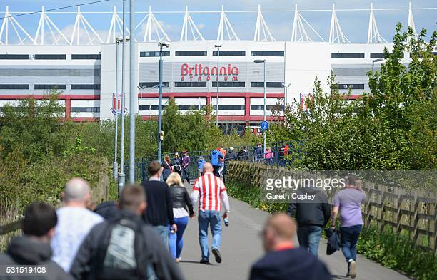 Supporters make their way to the staidum prior to the Barclays Premier League match between Stoke City and West Ham United at the Britannia Stadium...