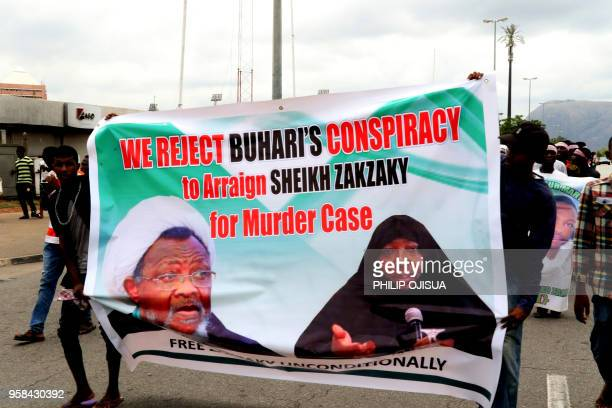 Supporters march with a banner to press for the release of Nigerian Shiite Muslim cleric Ibrahim Zakzaky on May 14, 2018 in Abuja. - The pro-Iranian...