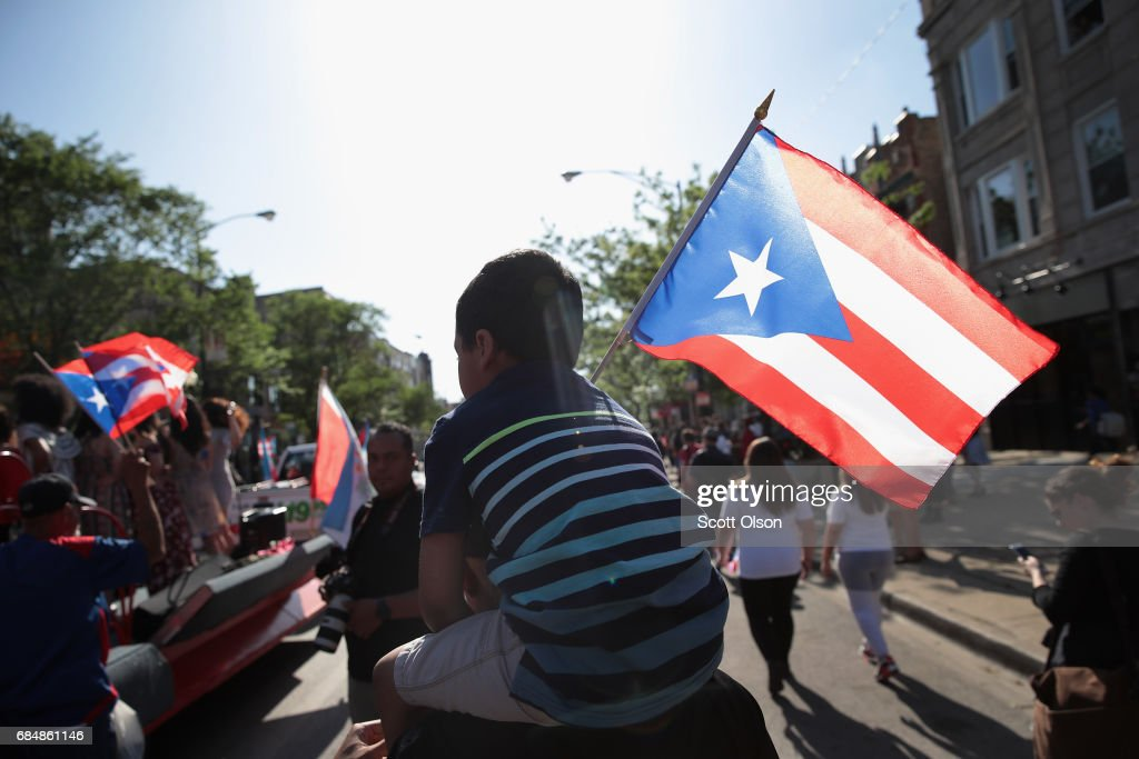 Supporters march with Puerto Rican nationalist Oscar López Rivera to a rally organized in Lopez's honor in the Humboldt Park neighborhood on May 18, 2017 in Chicago, Illinois. López, who once lived in Chicago was released from federal custody yesterday, his prison sentence being commuted by President Barack Obama before he left office. Lopez was one of the leaders of the Armed Forces of National Liberation (FALN), a Puerto Rican group that claimed responsibility for more than 100 bombings at government buildings, department stores, banks and restaurants in New York, Chicago, Washington D.C. and Puerto Rico during the 1970s and early 1980s.