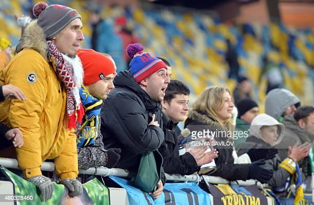 Supporters Metalist Kharkiv react during the UEFA Europa League Group L football match between FC Metalist Kharkiv and KSC Lokeren at the Lviv Arena...
