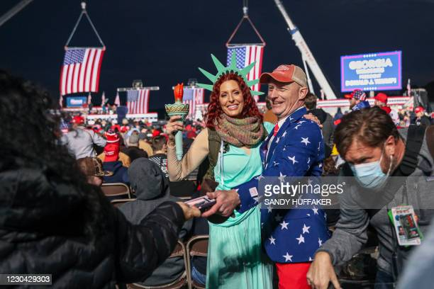 Supporters mingle before a rally with the US president in support of Republican incumbent senators Kelly Loeffler and David Perdue ahead of a Senate...