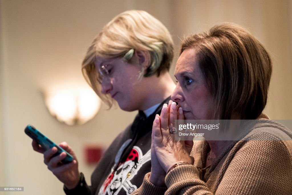Supporters monitor election returns at an election night event for Conor Lamb, Democratic congressional candidate for Pennsylvania's 18th district, March 13, 2018 in Canonsburg, Pennsylvania. As of 10:30 PM, Lamb's race against Republican candidate Rick Saccone is still too close to call.