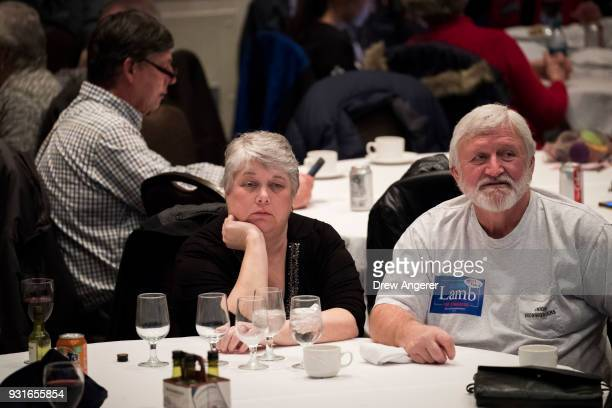 Supporters monitor election returns at an election night event for Conor Lamb Democratic congressional candidate for Pennsylvania's 18th district...