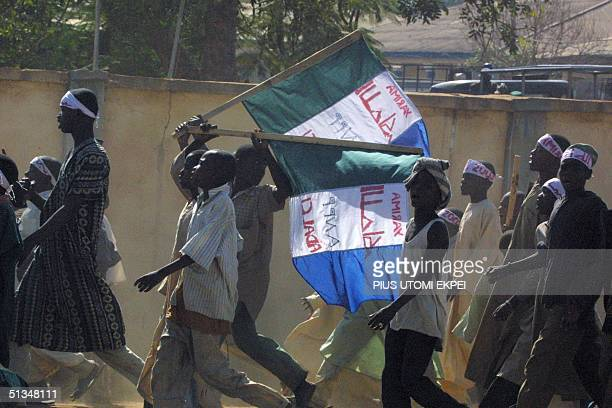 Supporters mostly children in their teens chant slogans in the town of Gusau in the Zamfara state 29 November 2002 The Zamfarans have upheld the...