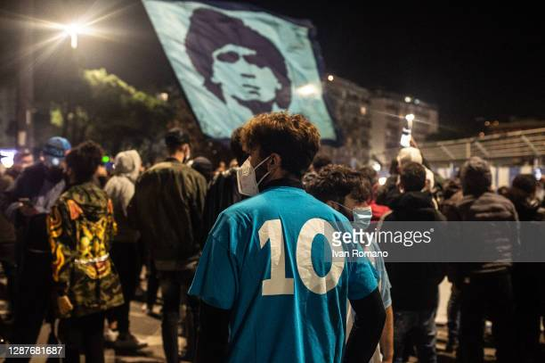 Supporters mourn the death of soccer player Diego Armando Maradona in front of the San Paolo stadium on November 25, 2020 in Naples, Italy. Diego...