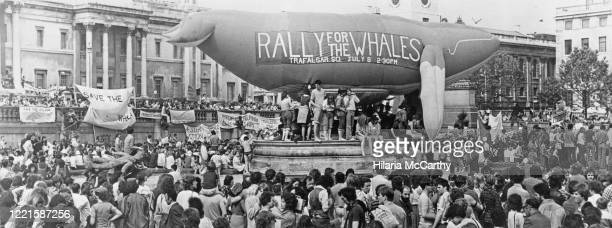 "Supporters near a 400 ft inflatable whale at the 'Rally For The Whales"" protest in Trafalgar Square, London, UK, 8th July 1979."