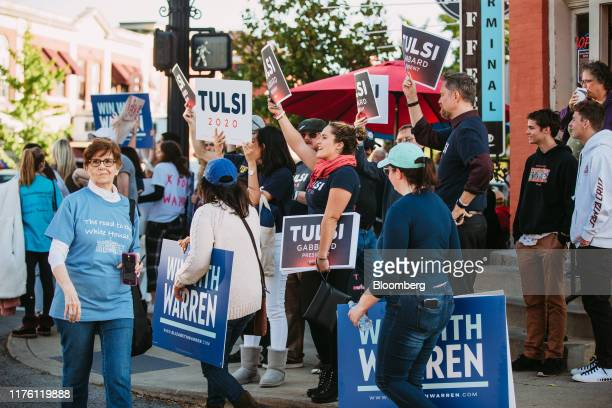 Supporters of 2020 presidential candidates Representative Tulsi Gabbard, a Democrat from Hawaii, and Senator Elizabeth Warren, a Democrat from...
