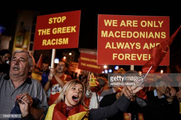 Supporters of a boycott for the namechange referendum celebrate in front of the Parliament in Skopje on September 30 as the vote was marred by a low...