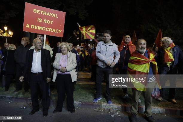 Supporters of a movement for voters to boycott the referendum celebrate after election officials gave low turnout figures in central Skopje,...