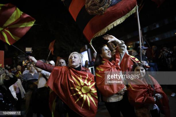 Supporters of a movement for voters to boycott the referendum celebrate after election officials gave low turnout figures in central Skopje Macedonia...