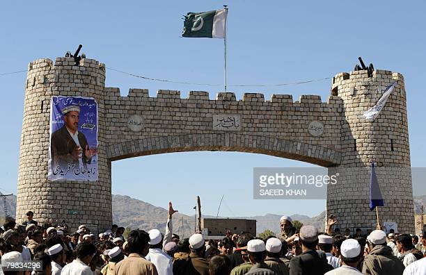 Supporters of a rival group shout slogans while blocking the main road at Derra Khyber during a protest against election results in one of the tribal...