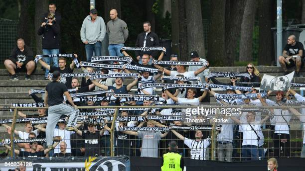 Supporters of Aalen cheer their team during the 3 Liga match between SV Meppen and VfR Aalen at Haensch Arena on September 10 2017 in Meppen Germany
