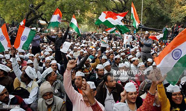 Supporters of Aam Adami Party during the party's victory rally after the party's good show in Delhi Assembly polls at Jantar Mantar on December 11...