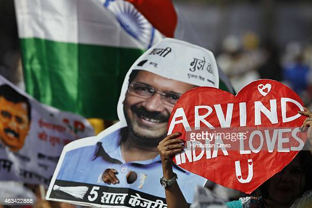 Supporters of AAP leader Arvind Kejriwal during his swearing in as Delhi Chief Minister at the Ramlila Ground on February 14 2015 in New Delhi India...